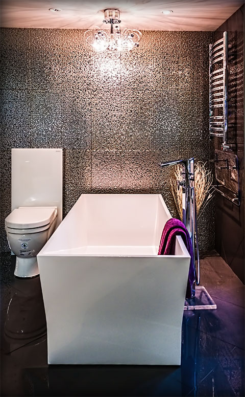 Photo of bathroom design with metallic walls.